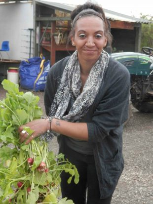 Volunteer with radish harvest