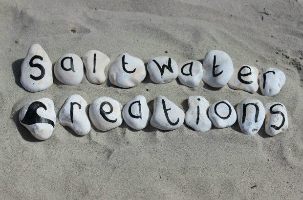Pebbles spelling Saltwater Creations