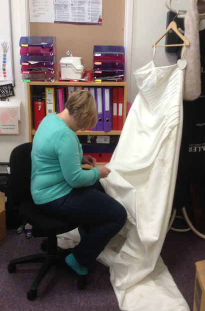 adjusting the wedding dress