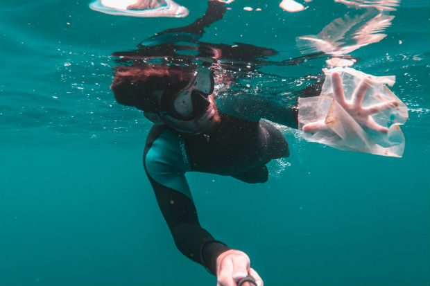 Diver collecting plastic underwater