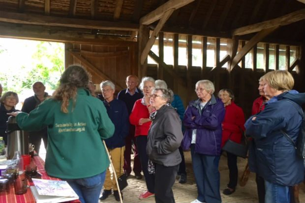 Visitors at a meeting with staff of Orchard Barn