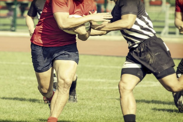 Men playing a game of rugby
