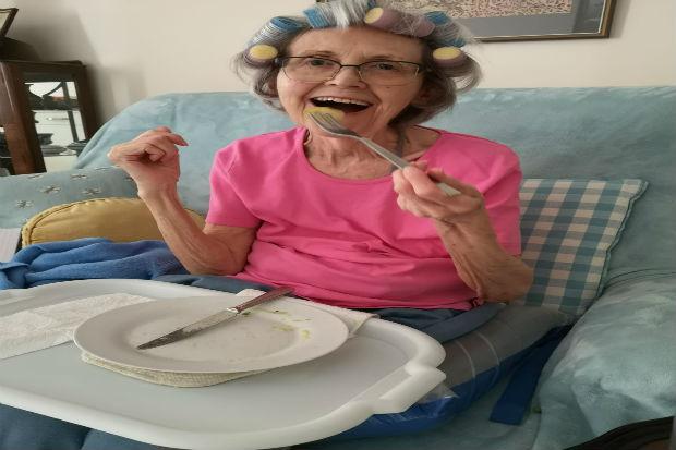 elderly lady finishing dinner