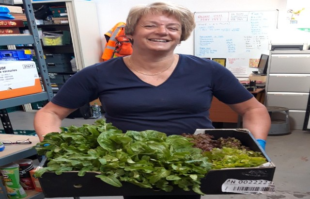 Sue with vegetables from our Foodbank