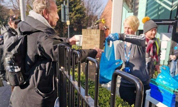 outside servery Hope Enterprises still feeding the homeless during the pandemic