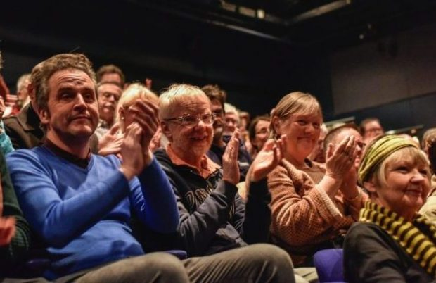 An audience enjoying the production