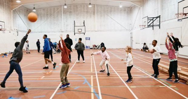 Group of young children taking part in Basketball training