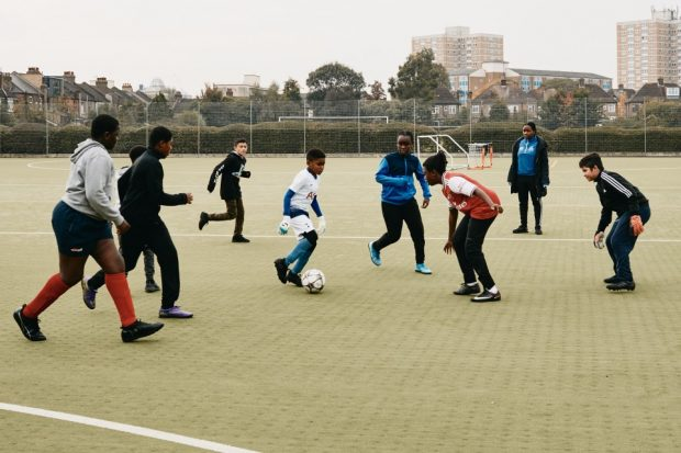 Group of young children participating in football training